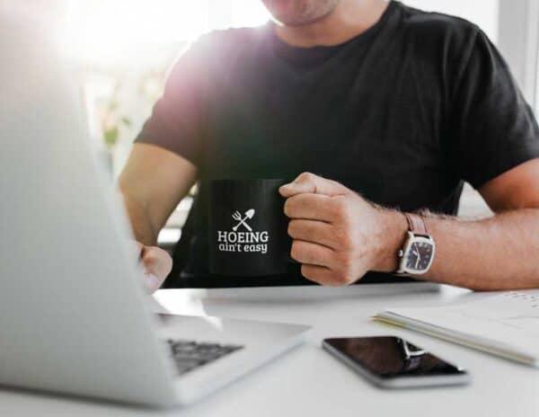 Hoeing Ain't Easy Black Coffee Mug Man